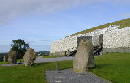 Newgrange Passage Tomb with 4 of the existing 12 standing stones.