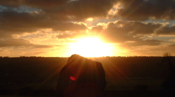 Sunrise over a standing stone at Newgrange.